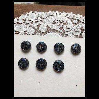 Seven Carnival Glass Buckle and Fleur-de-lis Buttons