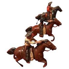 Set of Three 1940's Metal Toy Cowboy Figures