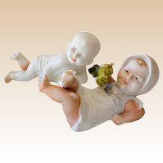 (2) Marked German Bisque Children Figurines Piano Baby