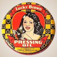 1930s Lucky Brown Hair Dressing Oil Tin Black Americana