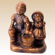 Vintage Jack and Jill Bronzed Metal Savings Bank