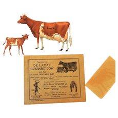 Complete De Laval Tin Guernsey Cow and Calf in Original Envelope 1910-1920