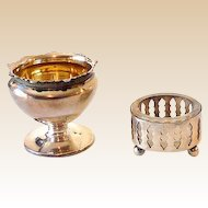(2) Unmatched Silver Plated Salts  Salt Keepers