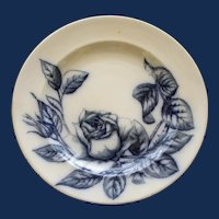 Antique Flow Blue Plate with Imposing Rose