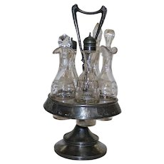 Antique Meriden 5 Bottle Castor Set with Silverplate Stand