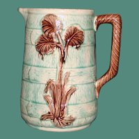Antique Majolica Green Barrel Stave Pitcher with Botanic Decorations