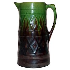 Tall Antique Majolica Brown and Green Pitcher