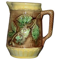 Antique Majolica Pitcher with Woven Background and Flowering Branch
