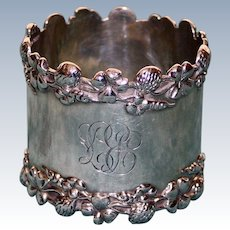Antique Sterling Napkin Ring with Four Leaf Clovers and Flowers