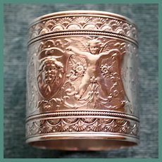 Antique Early American Coin Silver Napkin Ring with Winged Cherubs and Fantastic Faces