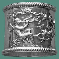 34.3 Gram Antique English Sterling Napkin Ring with Winged Musician Playing 2 Horns Attracting Birds, Harrold & Co., 1909