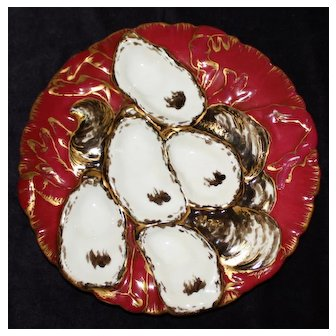 "Antique Claret ""Turkey Form"" Oyster Plate"