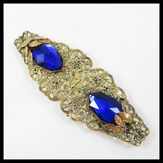 Victorian filigree belt buckle with large blue stones.