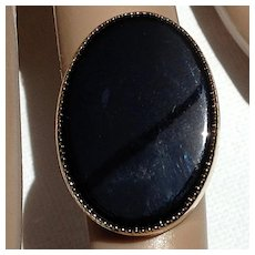 Vintage large black stone gold tone ring