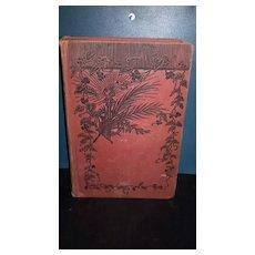 Treasure Island R. L. Stevenson hardback book. No dust cover. Red cover with black vine motif. Gold color lettering. Advance edition.