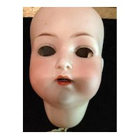 """Trebor Jointed 22"""" German Doll with Porcelain Face."""