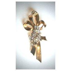Faux gold and rhinestone ribbon brooch