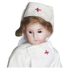 Paper Mache' Nurse Doll with bisque head