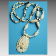 Crystal, Carved Bone & AB Peacock Necklace