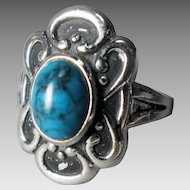Uncas Sterling and Dyed Turquoise Ring