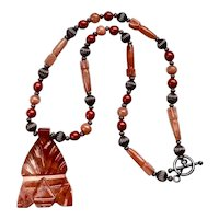 Artisan Carved Aztec / Mayan Mask Coral Jasper Stone Pendant Necklace