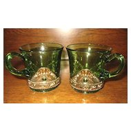 Eapg Glass Lacy medallion, green w/ gold mugs, Jewel pattern
