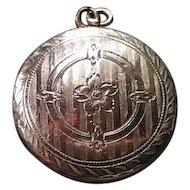 Gold Victorian locket, floral engraved