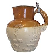 Antique German pottery jug with lid and relief work, 19th century