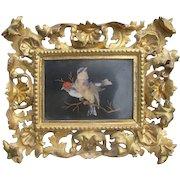 A Pietra Dura Panel set in a fine Florentine gilt wood frame, 19th century