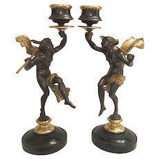 A pair of French gilt and patinated Bronze candle sticks by Felix Sanzel( 1829-1883)