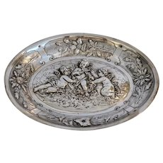 Antique Silver Repousse angel plate, 19th century