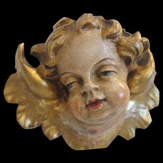 Vintage angel head, lime wood with polychrome painting, early 20th century