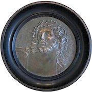 Antique copper plaque with the relief portrait of Jesus Christ, 19th century
