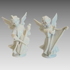 Pair of angels in biscuit porcelain, ca. 1920