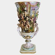 Capodimonte relief porcelain vase, signed and dated at ca. 1940