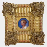 Antique painting  depicting a young child, gilt wood frame, 19th century