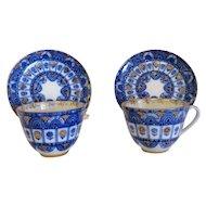 Russian Lomonosov porcelain tea cups and saucers, 1st half 20th century