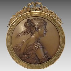 Antique Bronze plaque set in a gilt bronze frame, 19th century