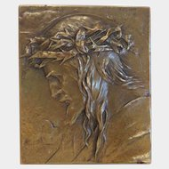 Bronze plaque depicting the profile of Jesus Christ,signed, ca. 1920