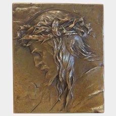 Bronze plaque depicting the profile of Jesus Christ,signed, ca. 1920