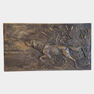 Antique bronze plaque depicting a hunting dog, 19th century