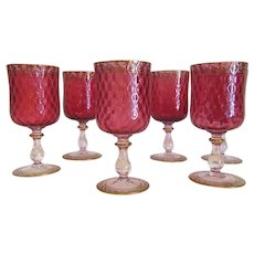 Six  Bohemian Cranberry crystal glass goblets, enamel and gold accents, ca. 1900