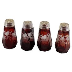 Set of Four Individual Salt Shakers in Ruby Red with Floral Cut Design