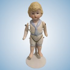 Vintage All-Bisque Boy Doll with Molded Clothes