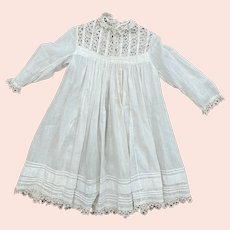 Antique child's dress with tatted yoke and hem