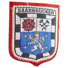 Vintage Woven Saarbrucken Travel Patch on Felt Background - Does Not Fluoresce