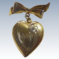 Vintage Gold Over Sterling Silver Heart Locket Dangling From A Bow Brooch