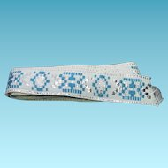 Pretty Vintage Jacquard Ribbon / Clothing Trim With Teal Silver & Metallic Against White Background