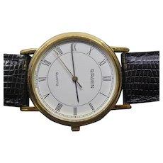 Gruen Quartz Wristwatch Round Face & Black Leather Band Runs Unisex 32mm across