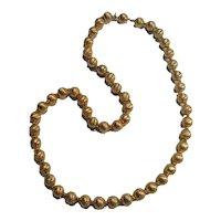 Trifari embossed gold tone metal bead necklace